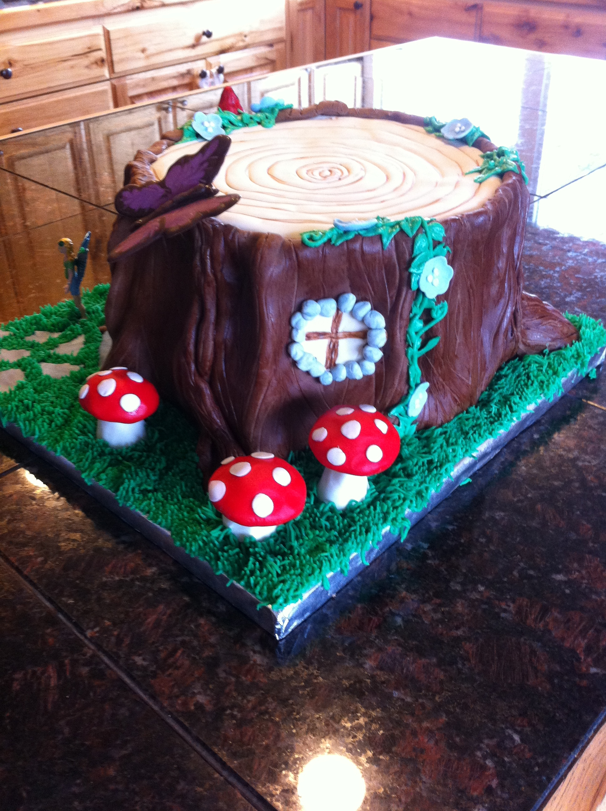 Cake Decorating Vines : Tree Stump Fairy House For A Little Girl Fondant Buttercream Grass And Vines Chocolate Butterfly ...