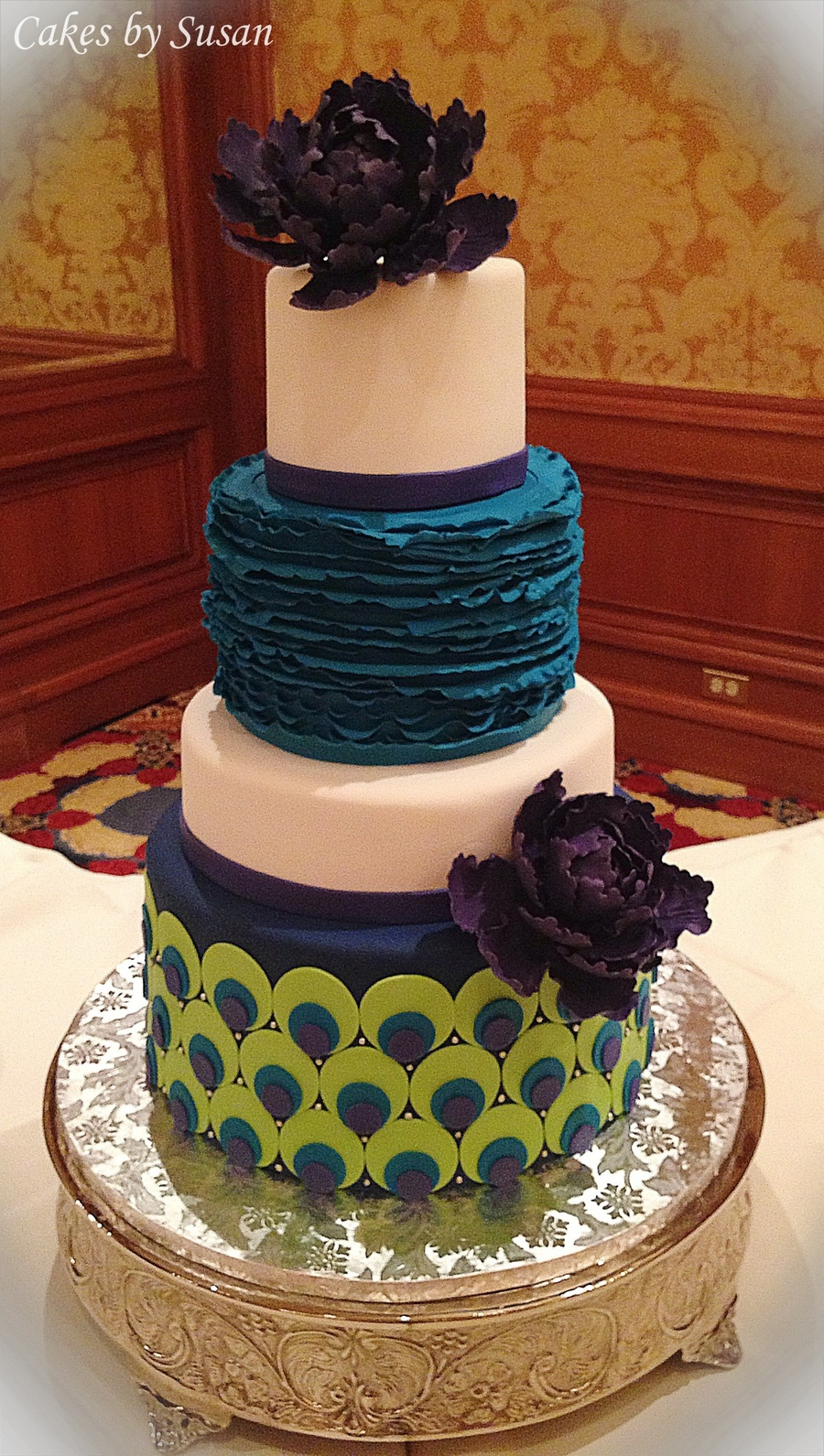 peacock colored wedding cakes peacock themed wedding cake with purple sugar peonies 18155