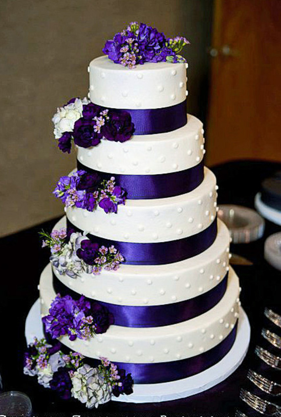how to make a 5 layer wedding cake 5 tier wedding cake iced in buttercream with fresh flowers 15789