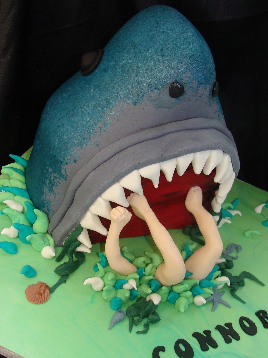 Great White Shark Eats Boy Shaped Moist Lemon Cake With Gumpaste Arms Legs And Shells Etc on Cake Central
