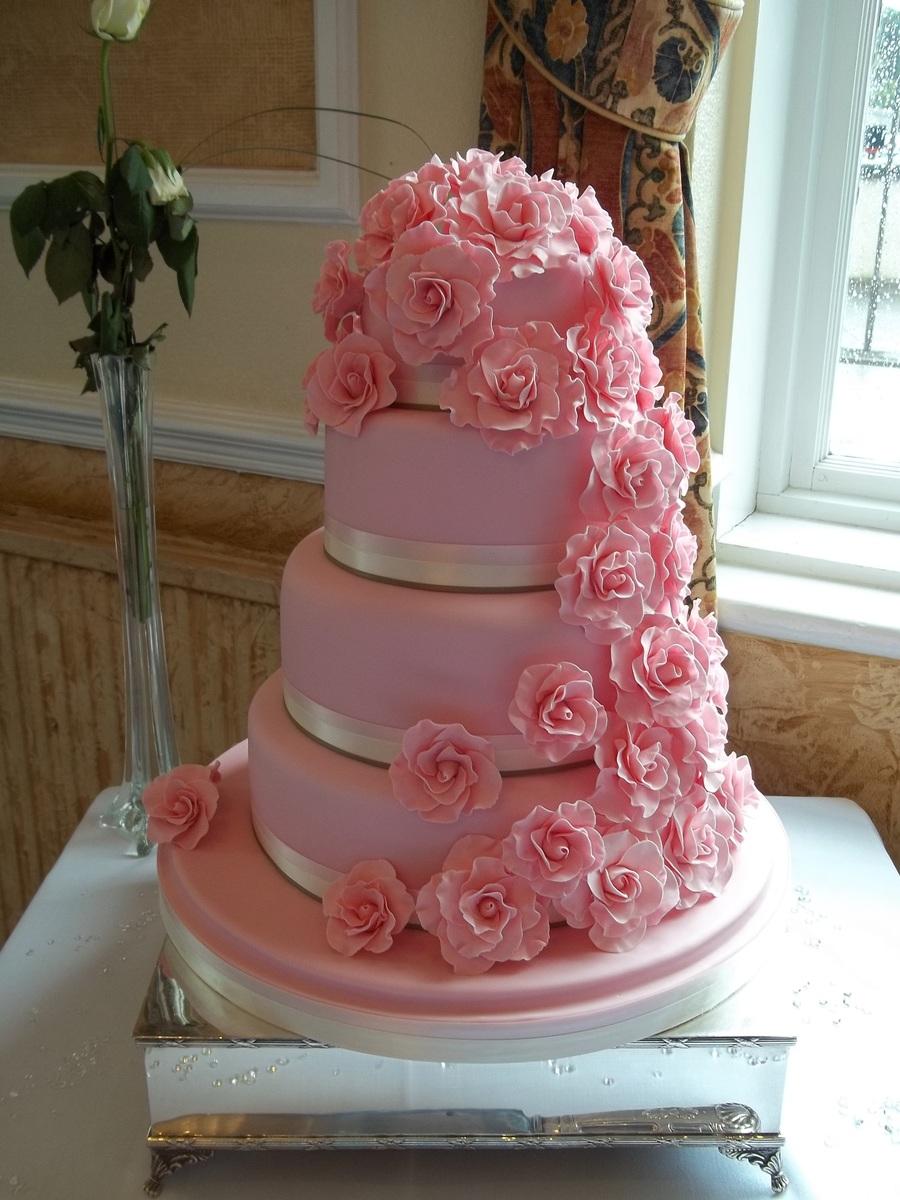 4 Tier Wedding Cake With Cascading Roses - CakeCentral.com