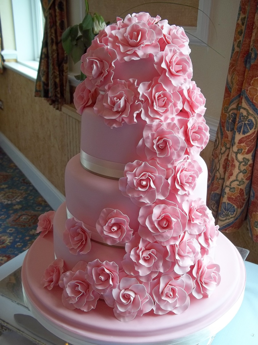 4 tier wedding cake with red roses 4 tier wedding cake with cascading roses cakecentral 10424