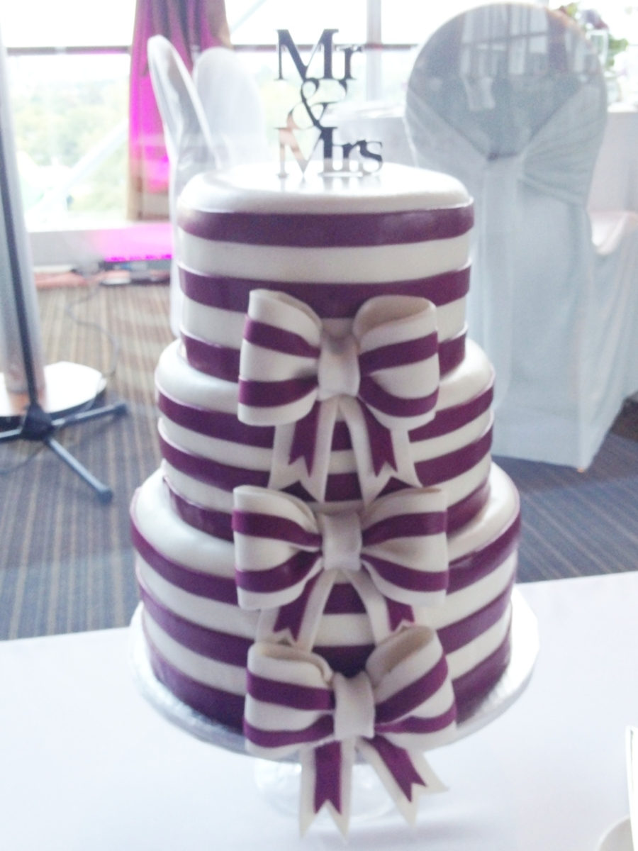 Purple Striped Bow Wedding Cake on Cake Central