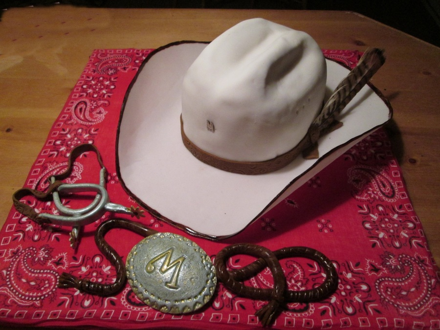 My Grandsons 10Th Birthday Cake. Cowboy Hat Is Cake   Spurs c3a01896fc4