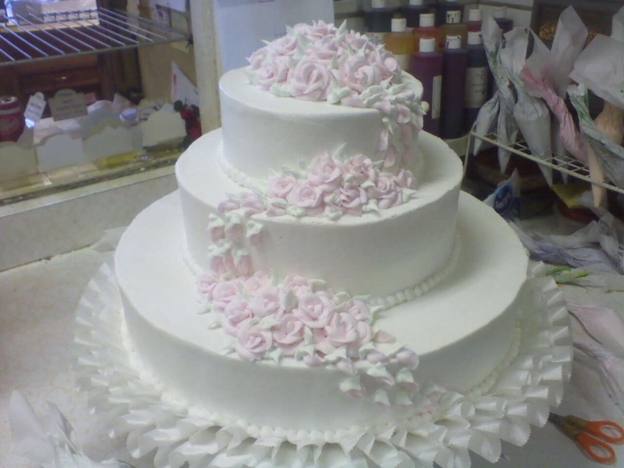 Pastel Roses Cascading on Cake Central