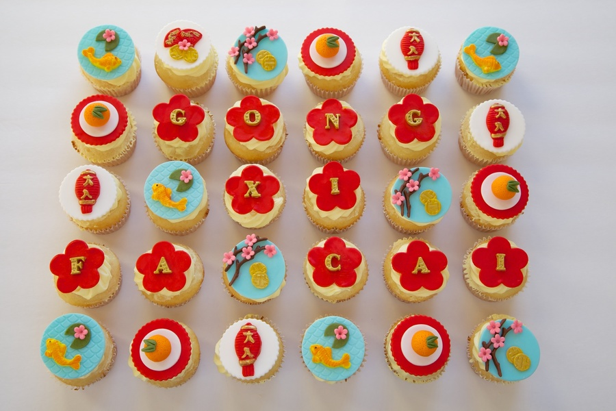Happy Lunar New Year Coconut Cupcakes With Mango Buttercream Frosting Amp Fondant Toppers  on Cake Central