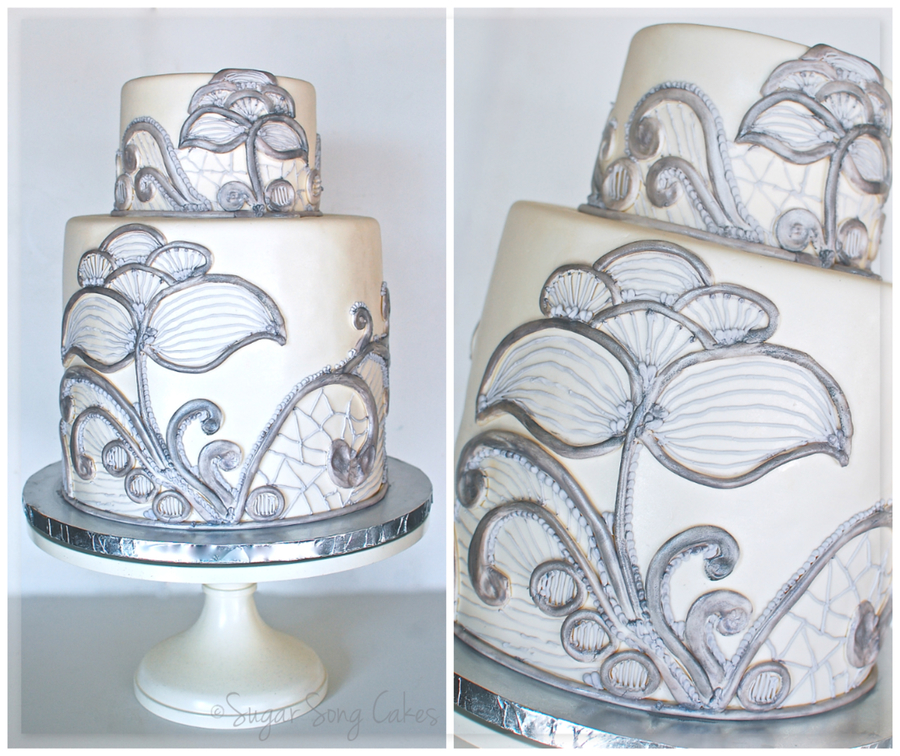 Double Barrel 10 Round With 6 Topper Fondant Covered With Hand Crafted Lace Made Of Fondant And Royal Icing That Was Painted With Silver on Cake Central