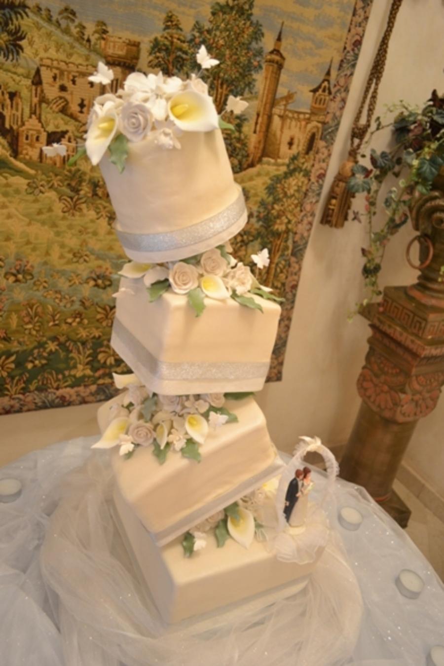 Topsy Turvy Caddy Wampus Wedding Cake - CakeCentral.com