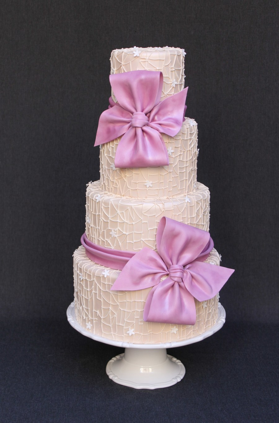 Spiderweb Lace And Light Plum Bows  on Cake Central