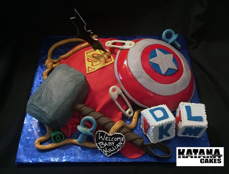 Superhero Themed Baby Shower Cake With Elements From Both Dc And