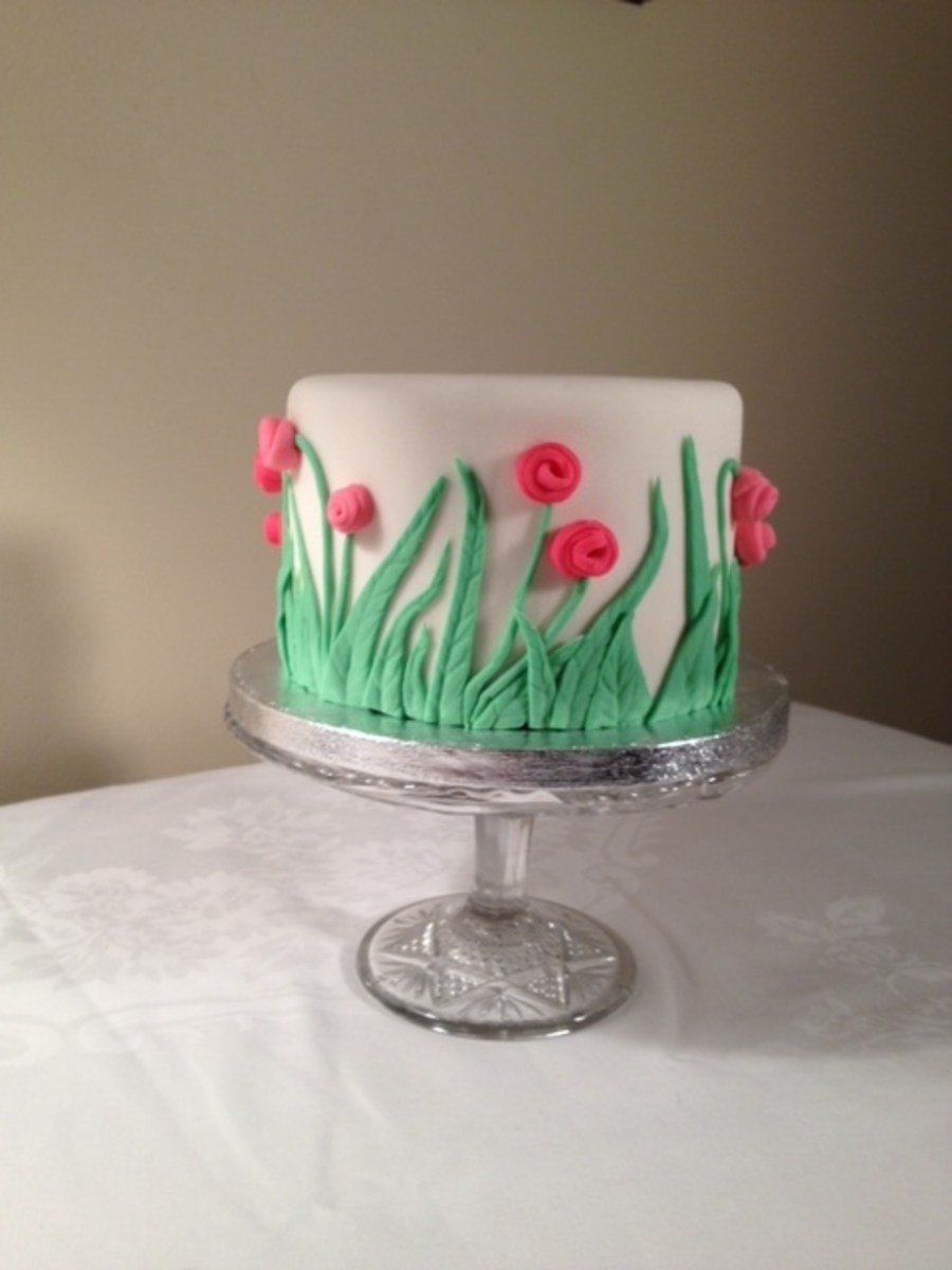 Fondant Covered Birthday Cake With 3 D Fondant Leaf And Flower Decor on Cake Central