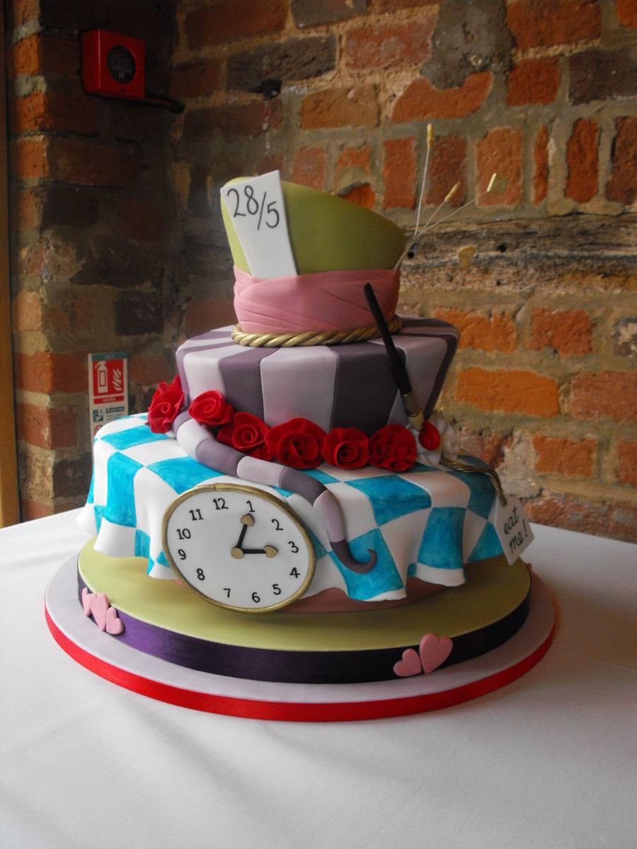 This Topsy Turvy Cake Has Details From Alice In Wonderland