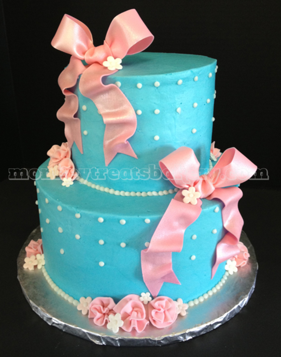 This Baby Shower Cake Was Based Off Of The Colors Of The Couplesu0027 Nursery  Decor   Pink And Turquoise. Iced In Buttercream With Fondant Bows And  Flowers.