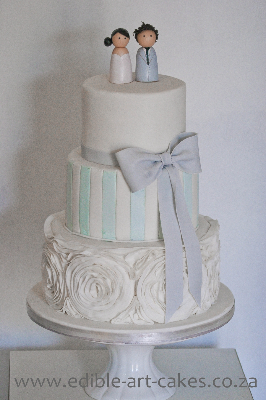 Elegant 3 Tier Cake With Ruffle Bottom And Our Edible Custom Made Toppers on Cake Central