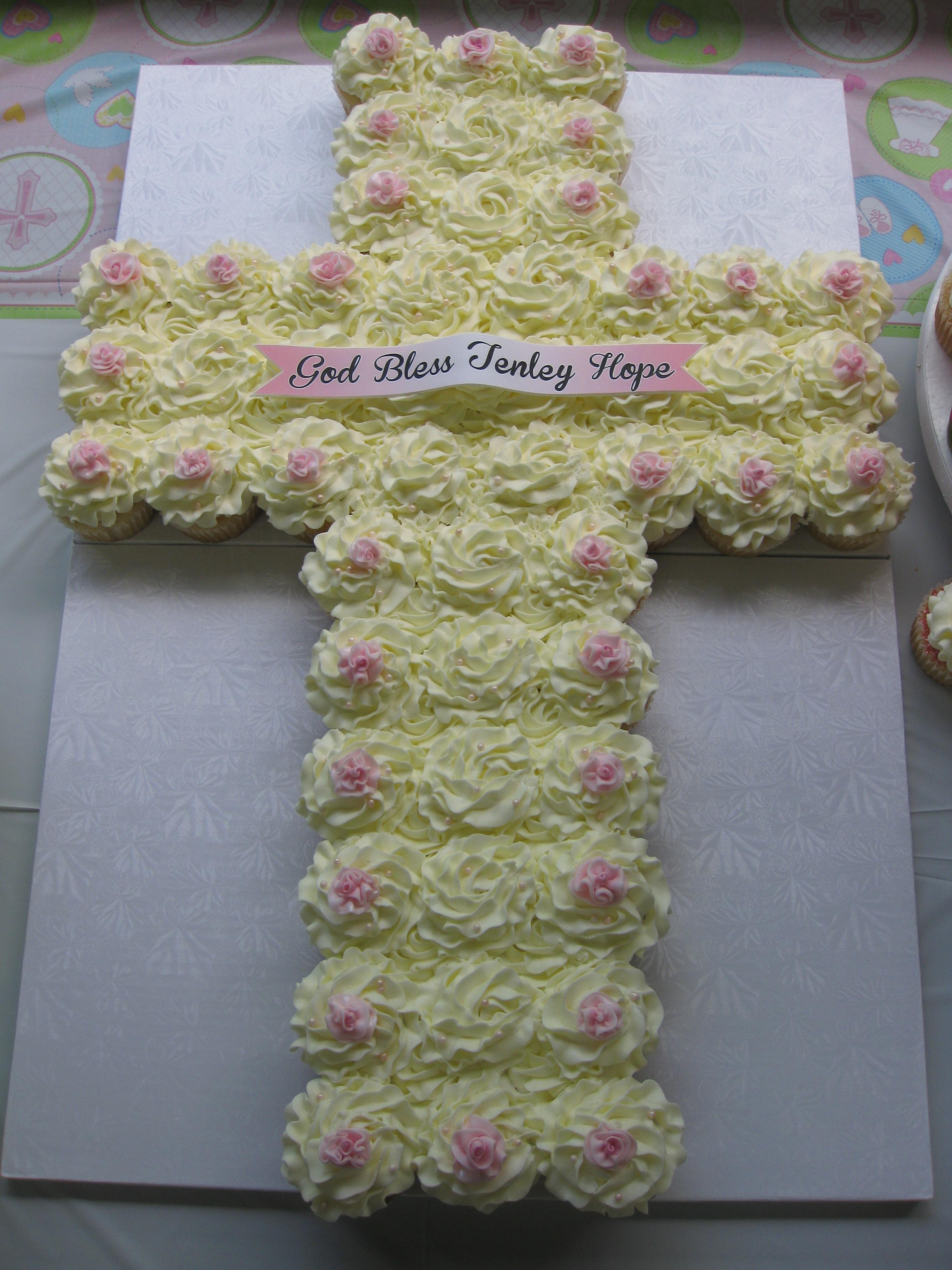 900_704067m5ta_baptism-cupcake-cross-with-fondant-roses-and-edible-banner.jpg