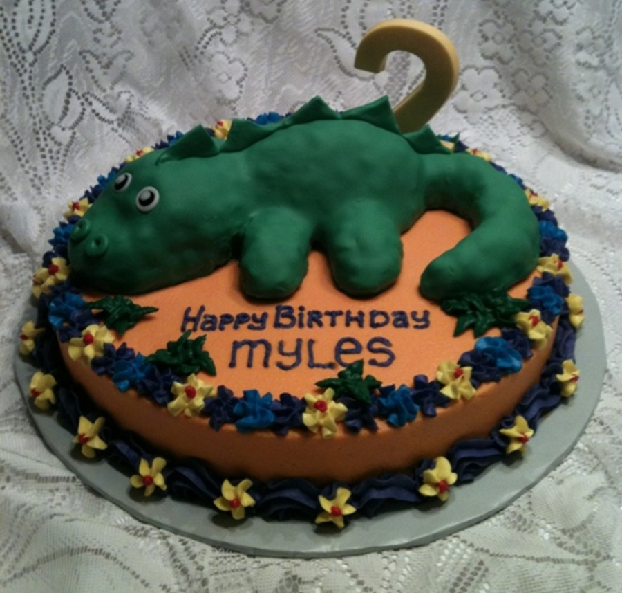 ... frosted and decorated w/ buttercream. dinosaur is RKT covered w/ MMF