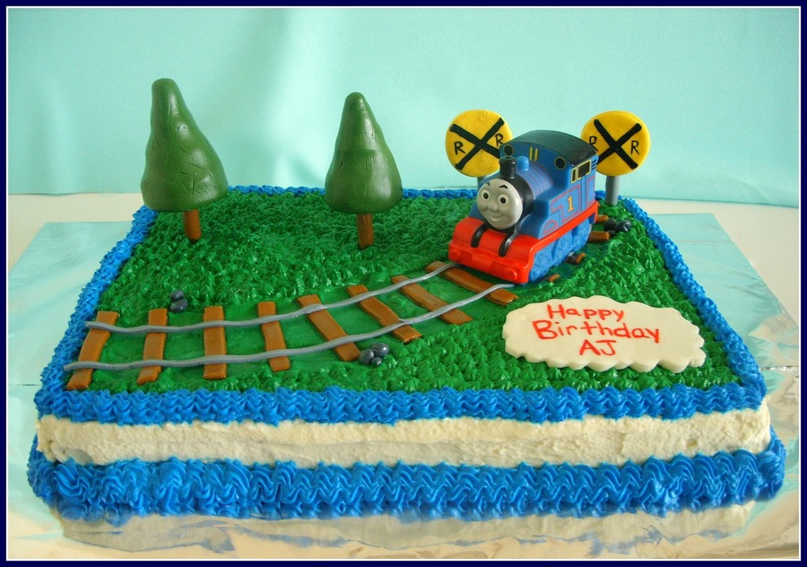 Strawberry Cake With Whipped Cream Frosting Railroad Trees And Signs Are Mmf Thomas Is A Toy on Cake Central