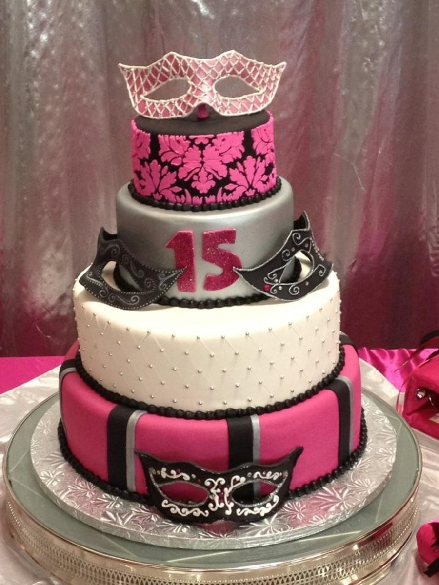 Quince With Gumpaste Masks on Cake Central