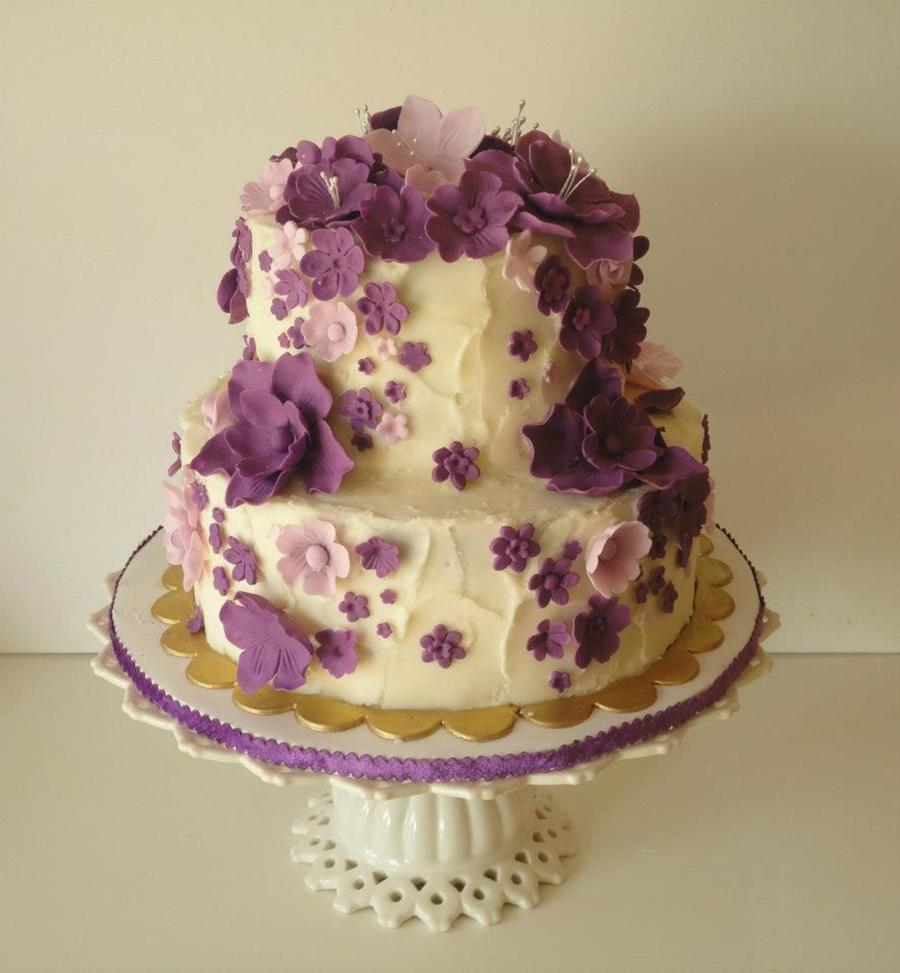 Cascading purple flowers birthday cake cakecentral two tier chocolate cake with whipped ganache filling frosted in buttercream in a stucco style flowers are a mix of fondant and gumpaste it was a birthday izmirmasajfo