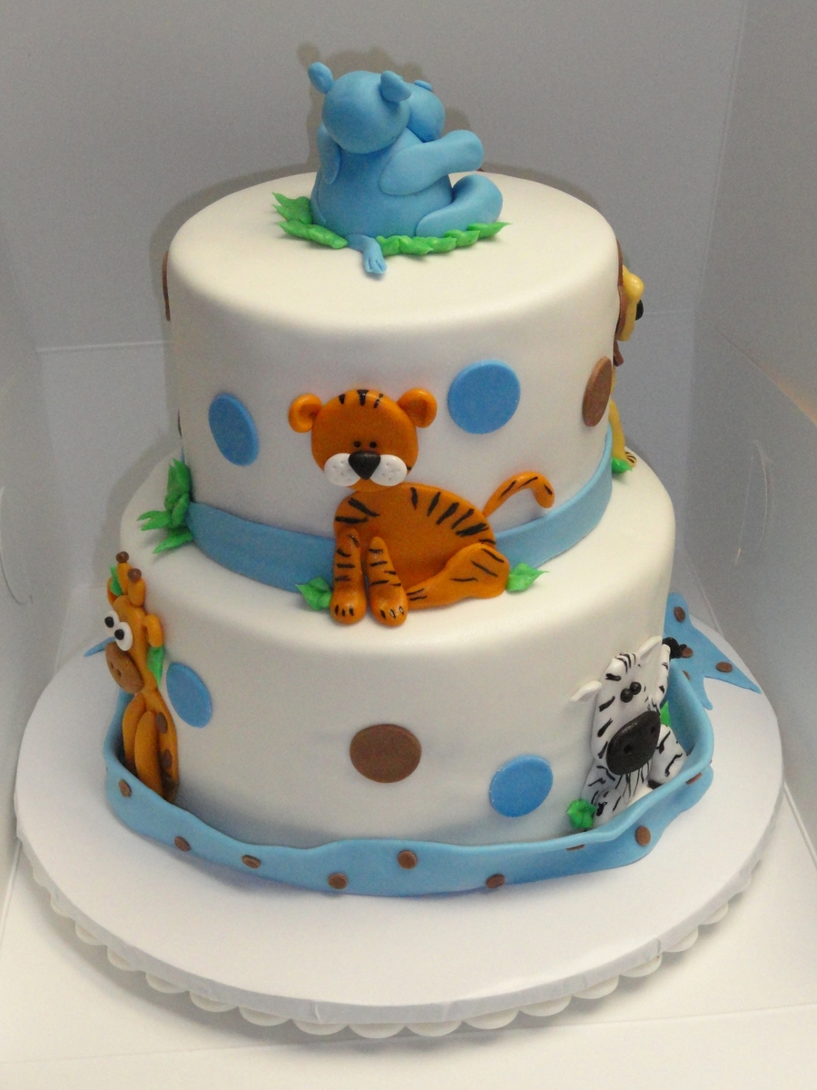 Jungle animal baby shower cake for Animal cake decoration