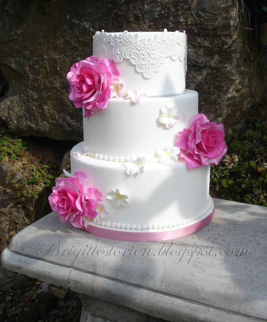 Wedding Cake With Lace And Pink Roses Und Flower Fillers on Cake Central