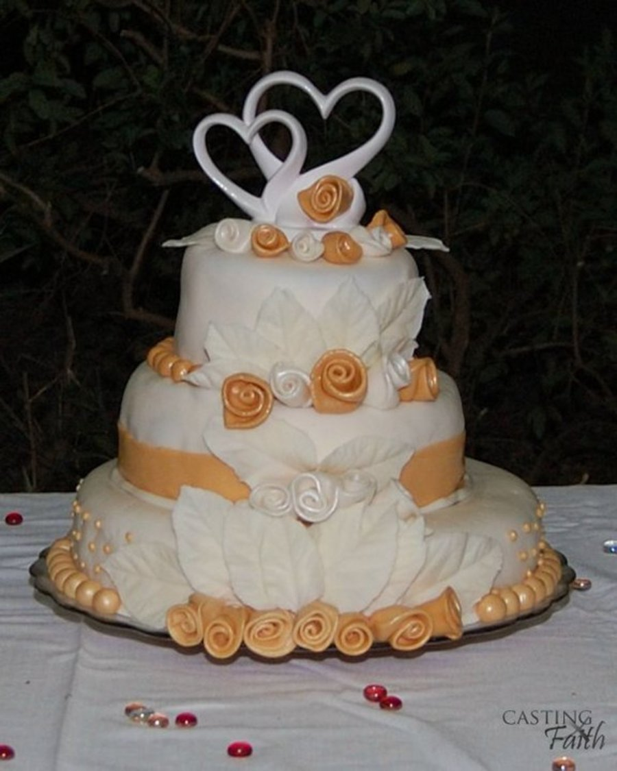 Gold And White Wedding Cake With Ribbon Roses - CakeCentral.com