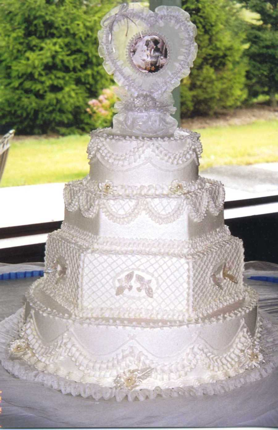 Wedding Cake Iced And Accented With Buttercream Icing Added ...