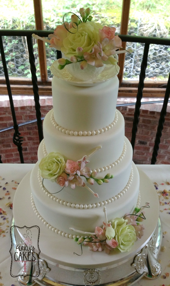 4 Tier Wedding Cake With Roses Freesias And Mini Guitars For An Antique Tea Party Theme I Made The As A Surprise Groom Plays