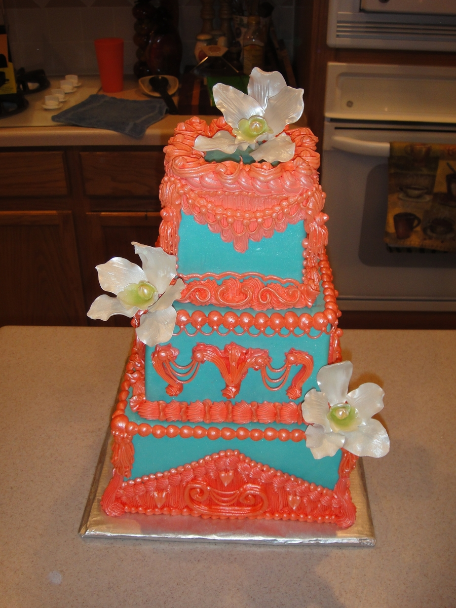 Turquoise & Coral With White Orchids on Cake Central