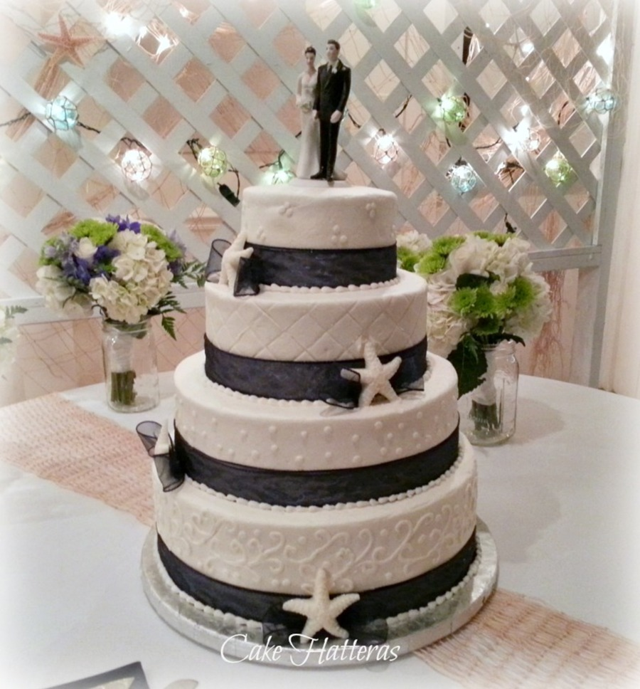 A Buttercream Iced 4 Tier Wedding Cake With Piping And White Chocolate Starfish on Cake Central