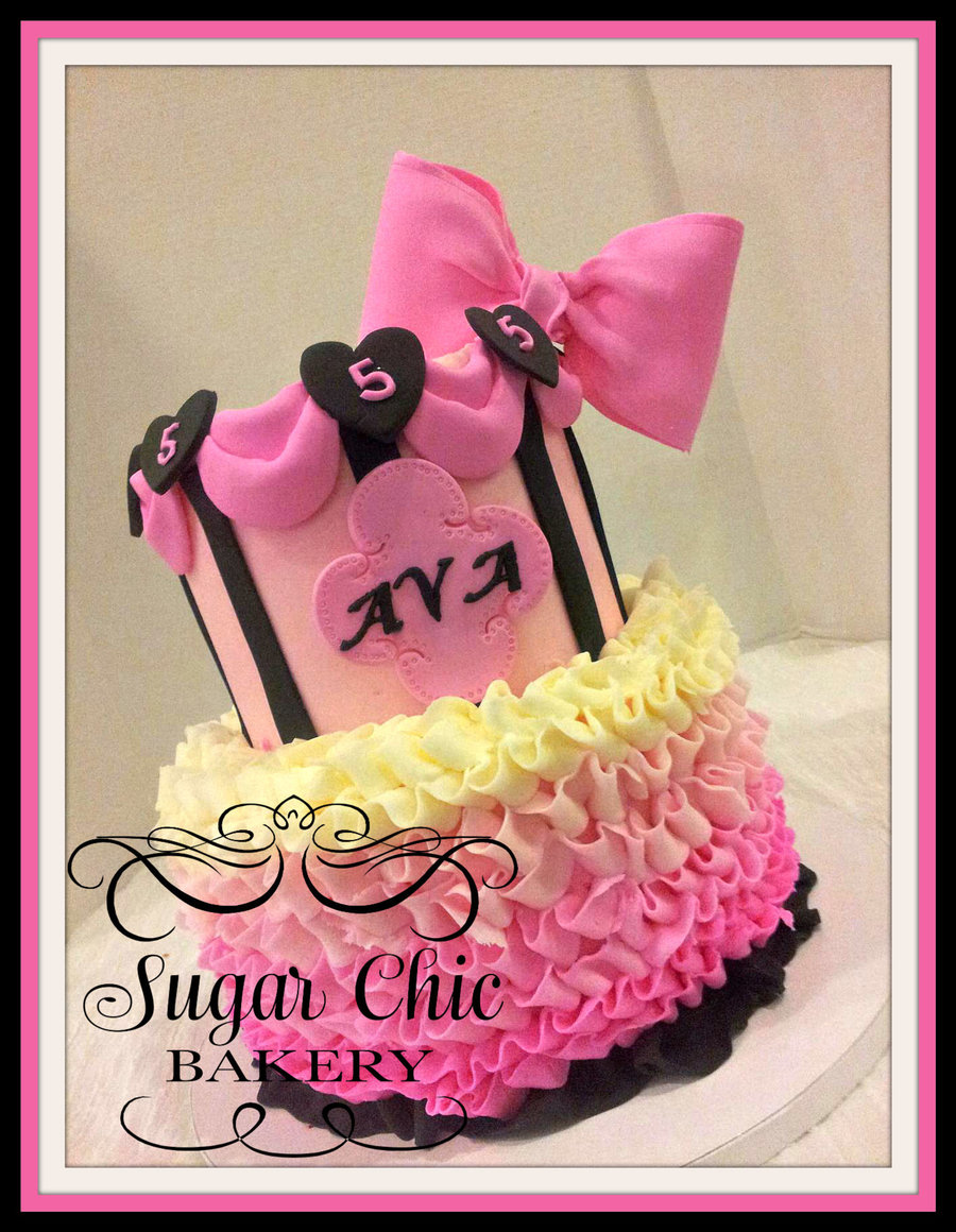 Buttercream ruffles, buttercream tiered cake with fondant accents.