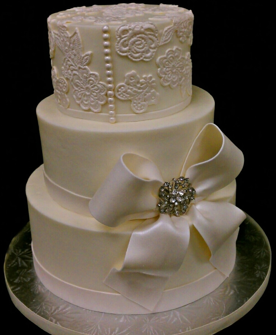 Lovely Round Wedding Cake In Buttercreaam With Fondant Bow And Purchased Brooch Go Buttercream on Cake Central