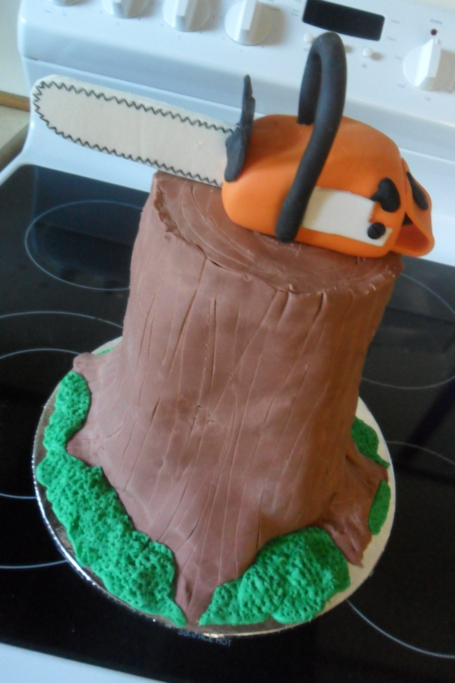 Chainsaw On A Stump on Cake Central