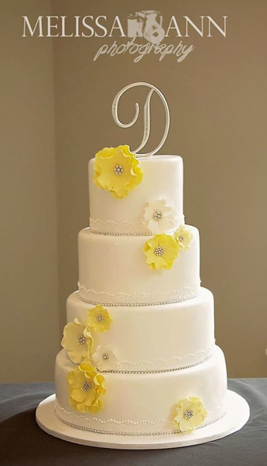 Yellow And White Wedding Cake Top And Bottom Tiers Were Lemon With ...