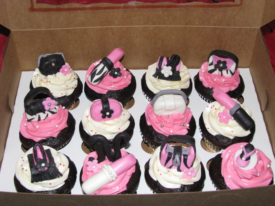 these cupcakes theme was pink zebra print shoes lipstick and purses i especially love the lipstick with the zebra print bridal shower