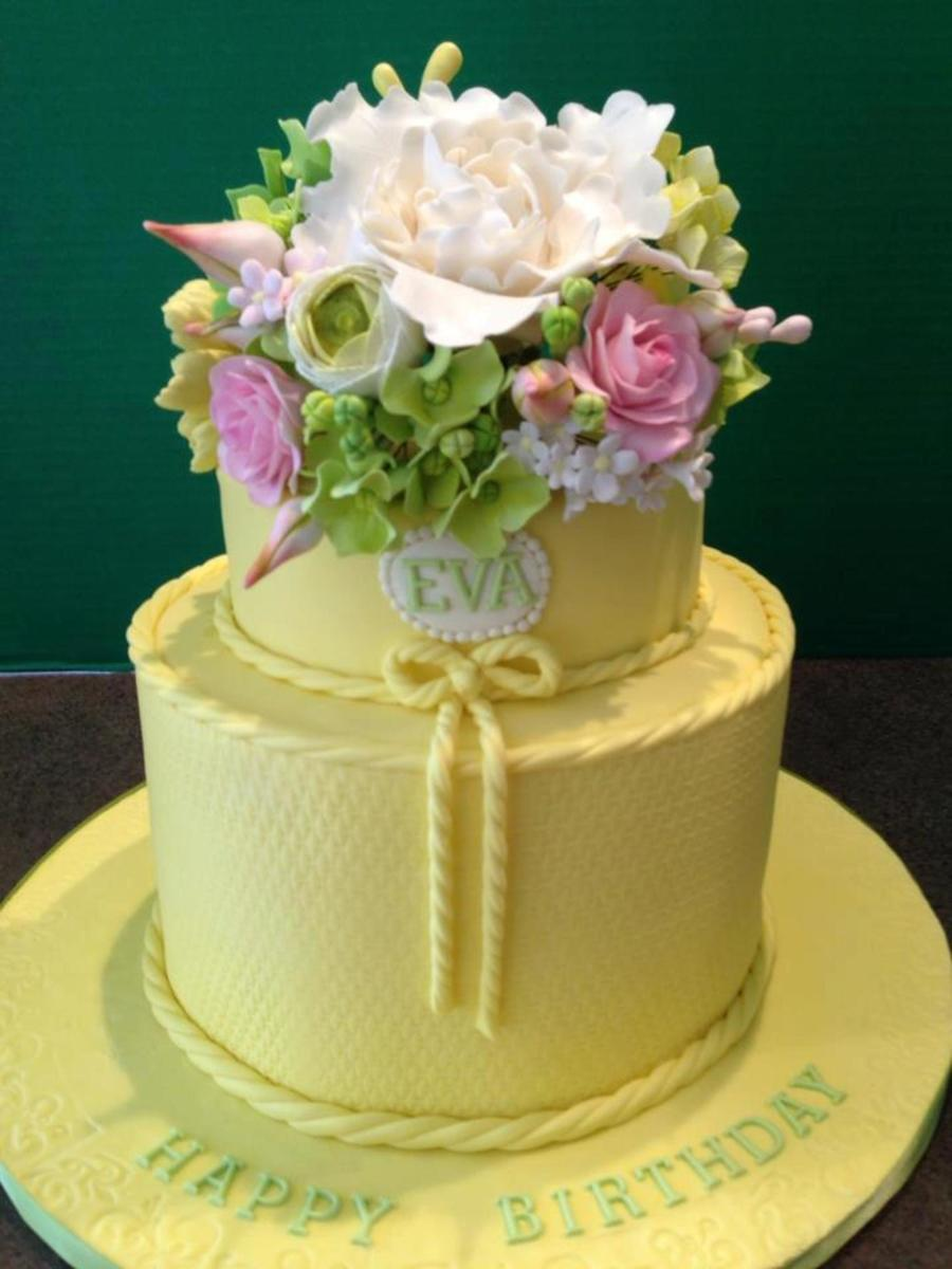 Yellow 2 tier 80th birthday cake with gumpaste flowers cakecentral yellow 2 tier 80th birthday cake with gumpaste flowers on cake central izmirmasajfo
