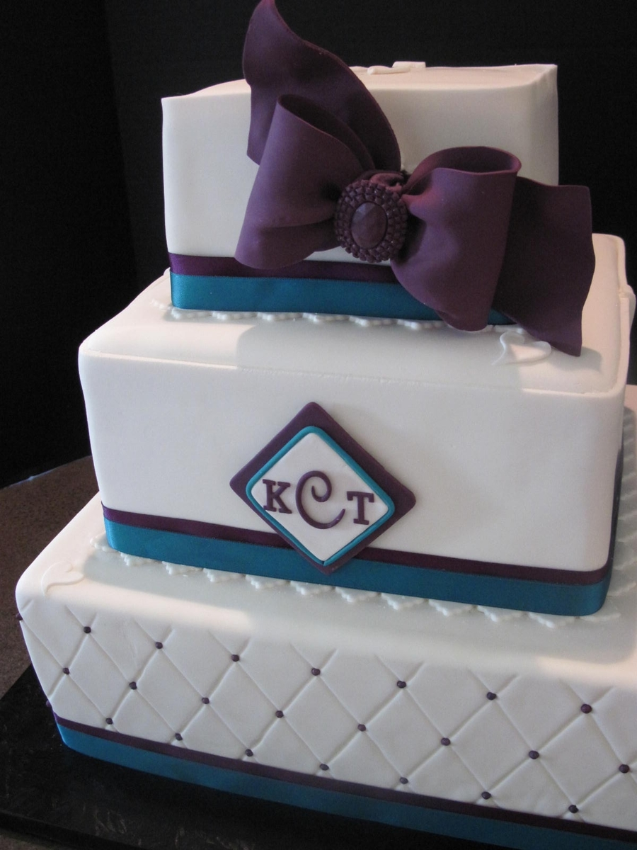 Silver Square Cake With A Blue Bow