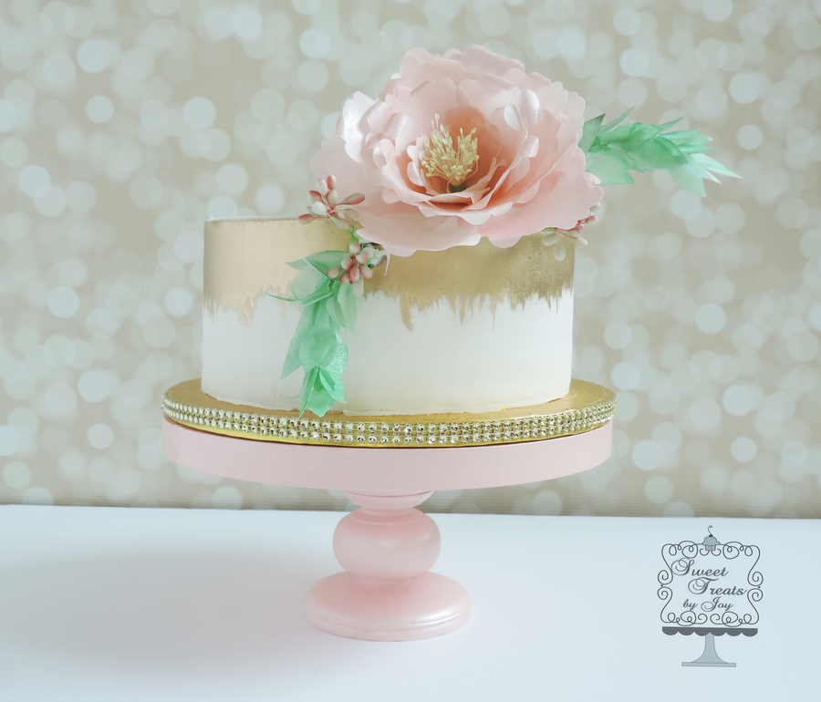 Cake was painted with gold luster dust paper wafer flowers to accent on cake central