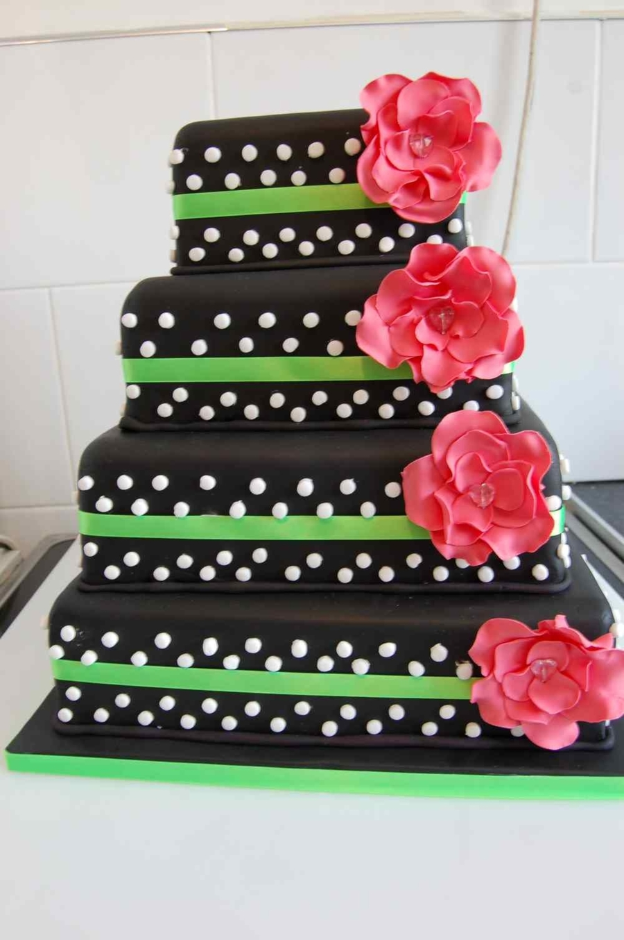 Black With White Polka Dots And Pink Flowers on Cake Central