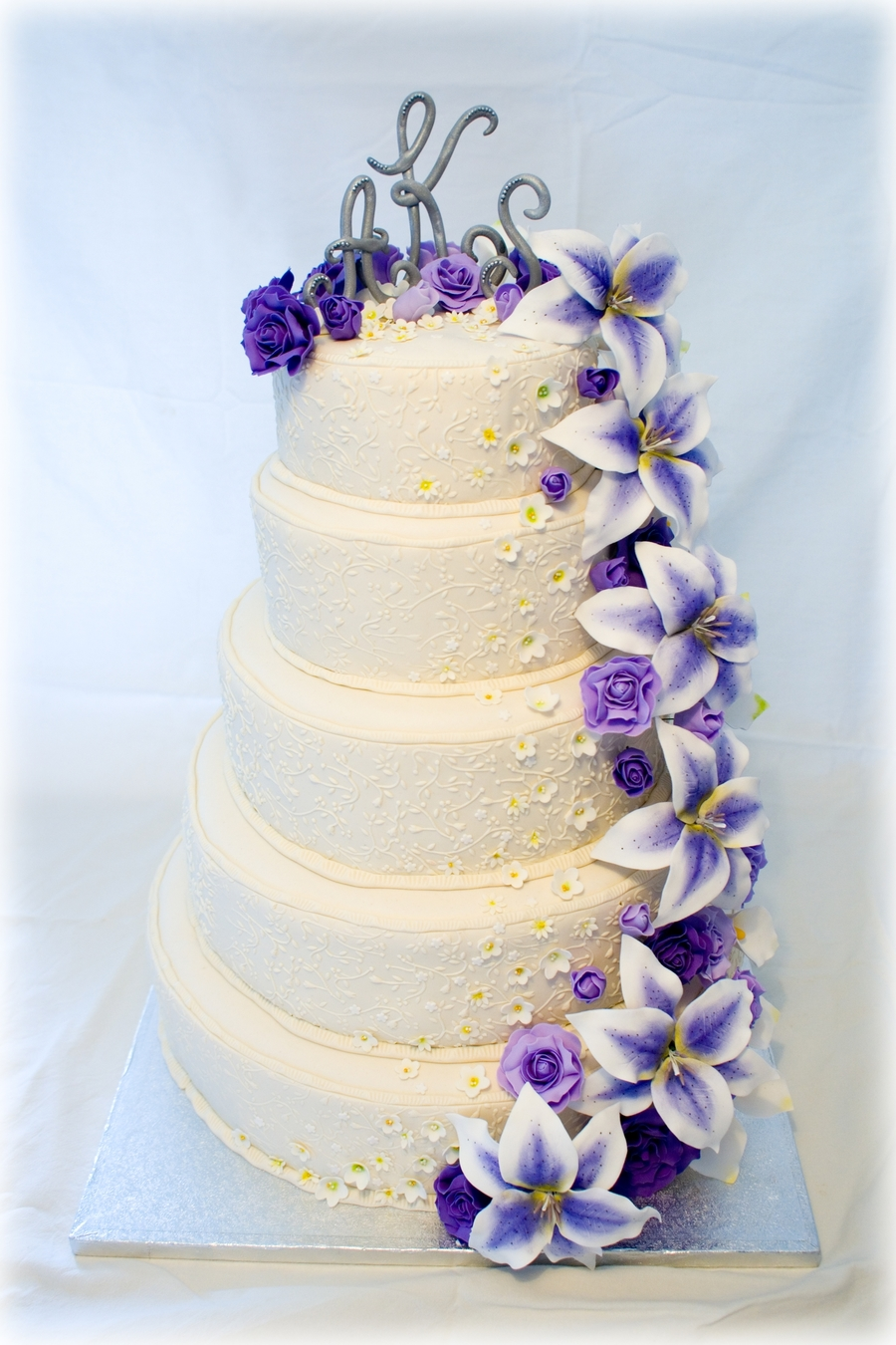 wedding cake with purple flowers wedding cake with purple flowers cakecentral 26946