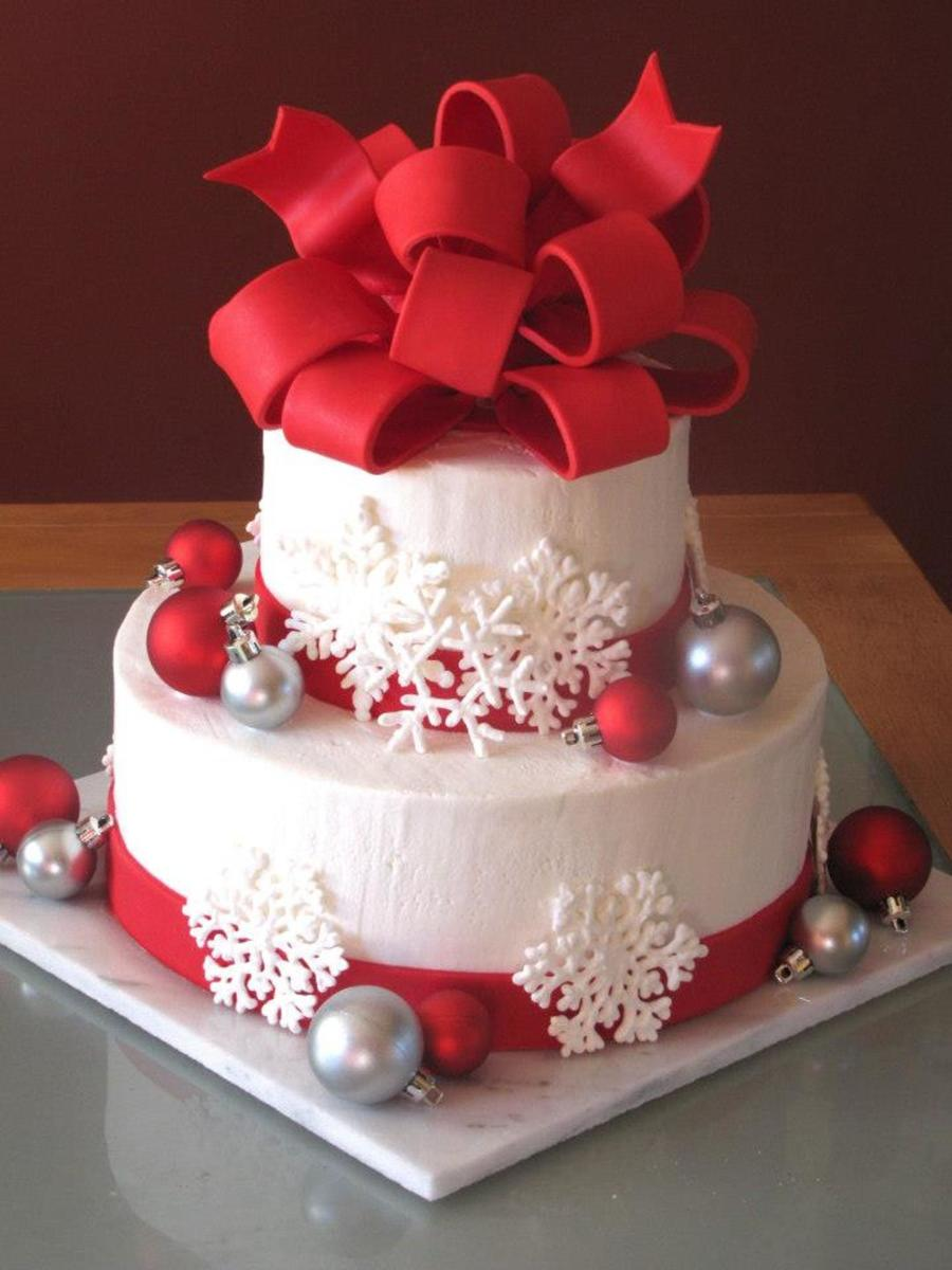 my very first wedding cake for a christmas themed wedding on 121212 bottom tier 10 round top tier 6 round both tiers were wasc with cookies