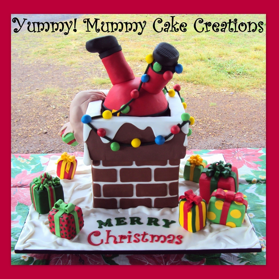 Oh no santa 39 s stuck in the chimney christmas cake Santa stuck in chimney cake