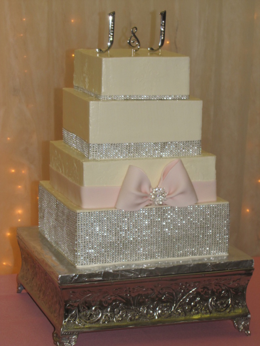 Smbc Frosting With A Bling Wrap Gumpaste Bow And Crystal Brooch on Cake Central