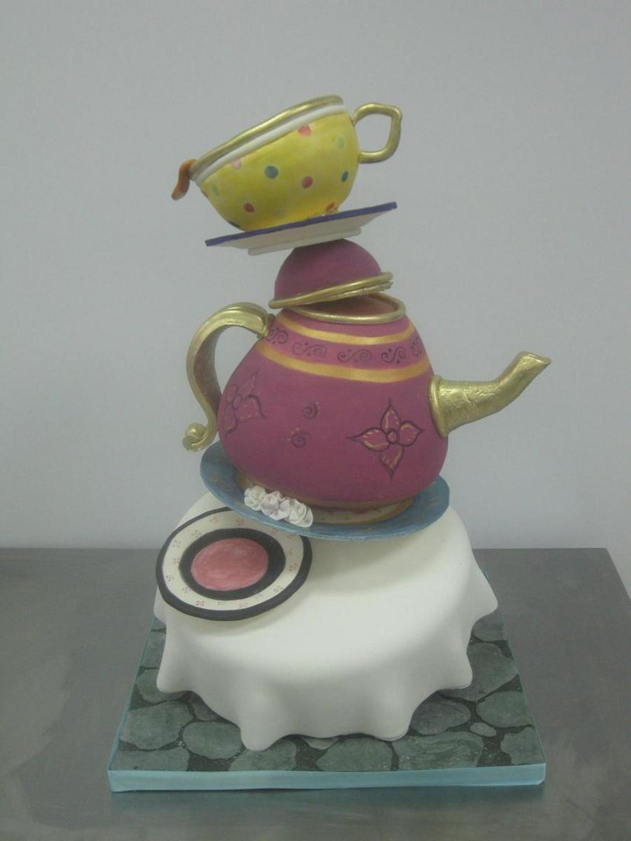 Topsy Turvey Tea Cup Cake on Cake Central