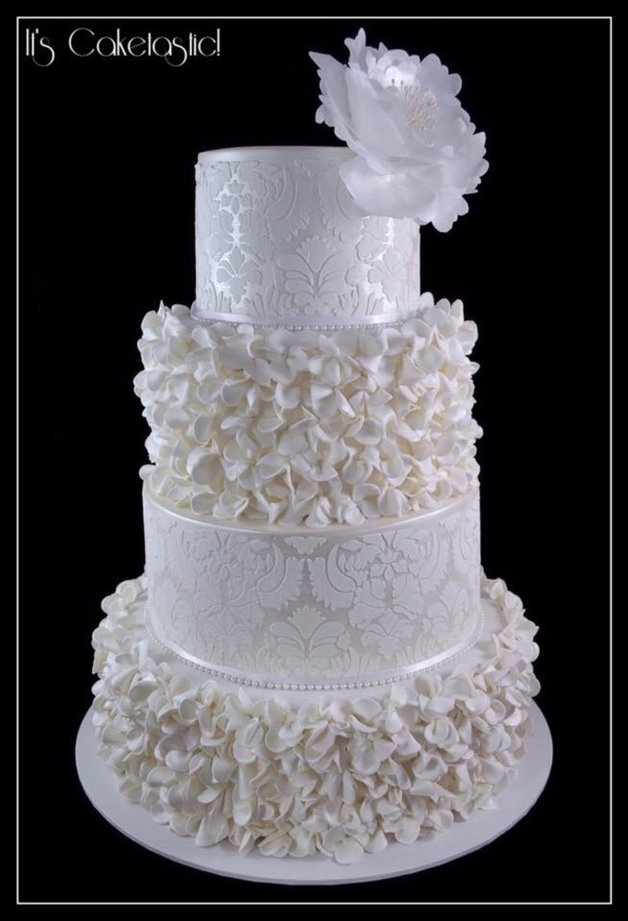 White And Pearl Wedding Cake With Ruffled Flowers CakeCentralcom