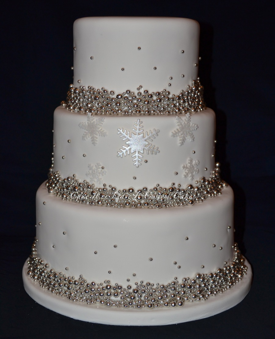 Ivory Wedding Cake On A Whote Stand