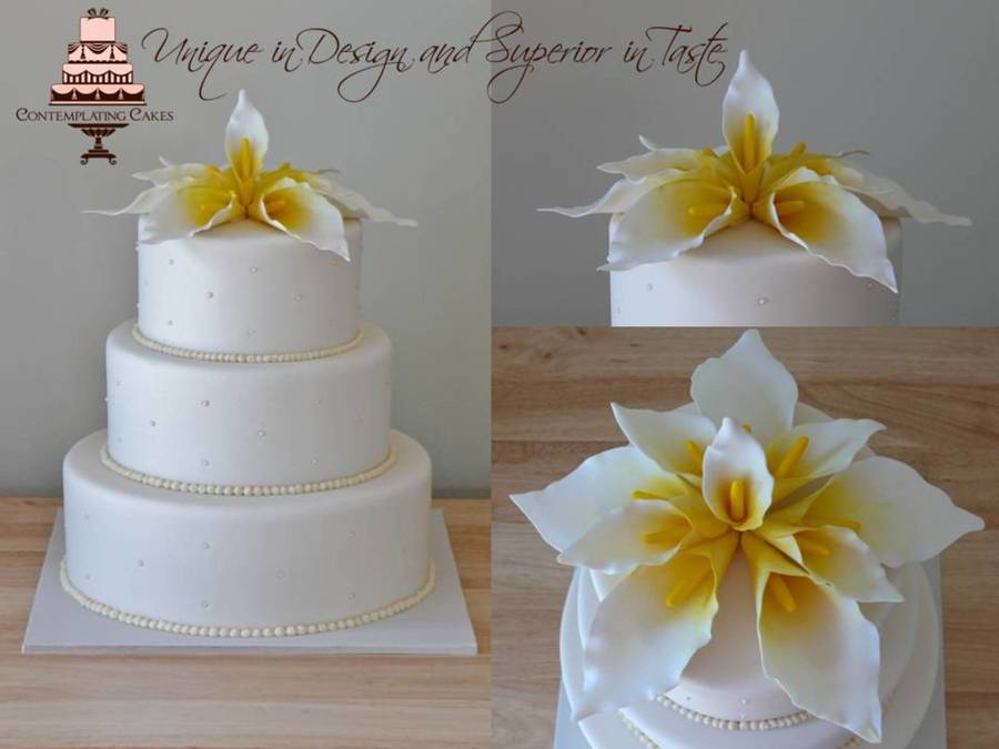 An Elegant 3 Tier Ivory Wedding Cake Featuring Hand Crafted Calla Lilies This Design Was Presented To Me By The Bride And Groom And Was Ins... on Cake Central