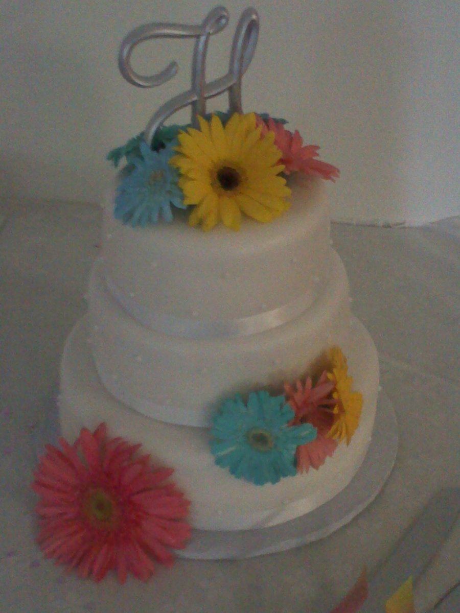 White Wedding Cake With Real Gerbera Daisys on Cake Central