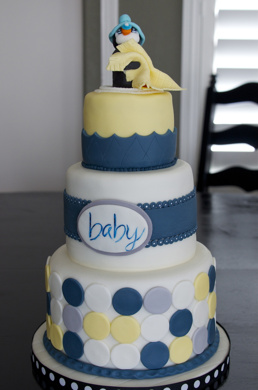 Baby Shower Cake...nursery Colors Are Navy Blue, Yellow, Gray And White.  Mom To Be Loves Penguins So There Is A Baby Penguin At The Top.