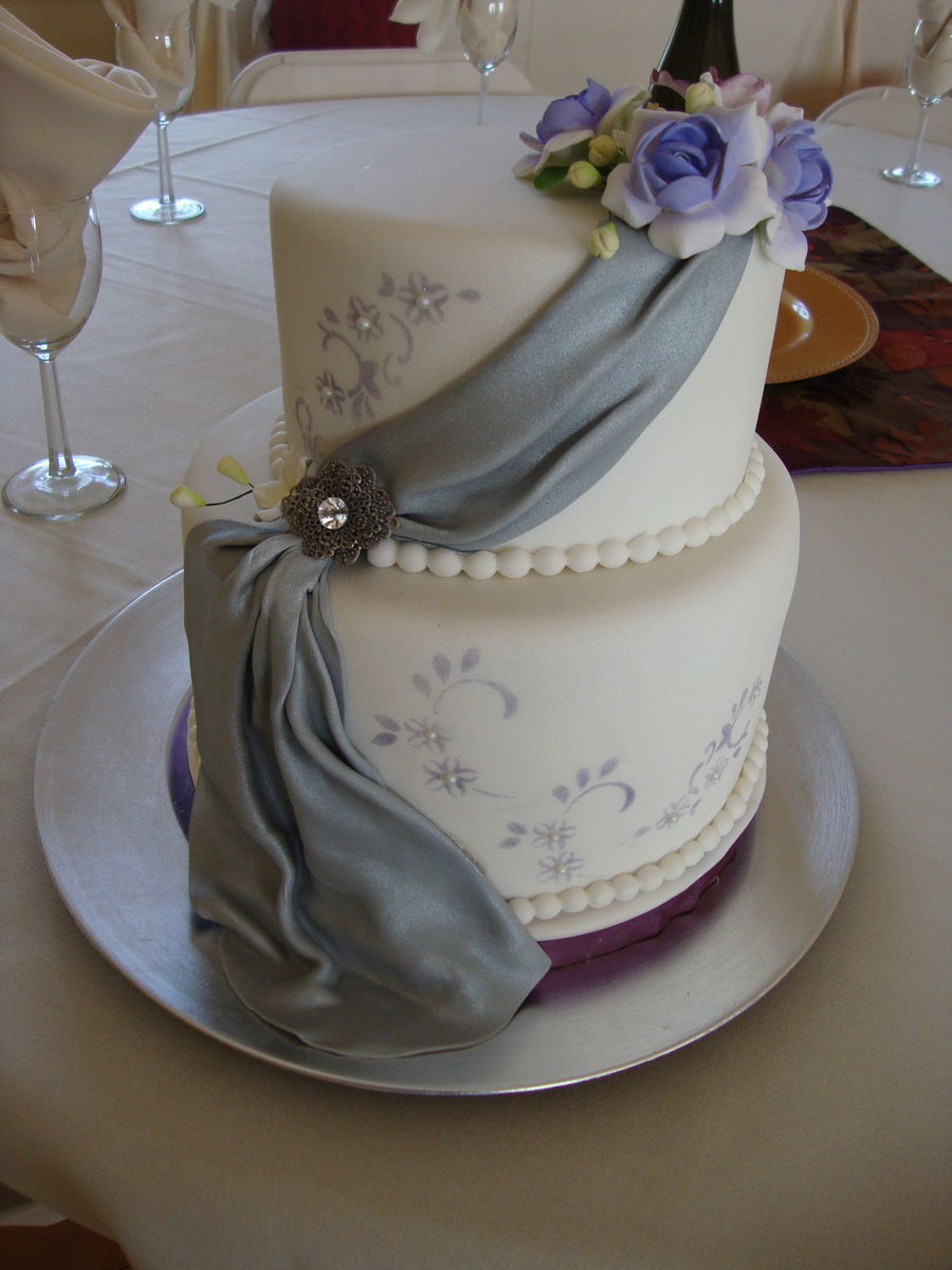 Lovely Two Tiered Wedding Cake With Fondant Drape And Stenciled Accents on Cake Central